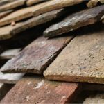 Illinois slate tile roof - image of damaged slate tiles